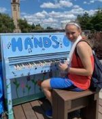 Lily at an outside piano in Spokane